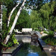 Contemporary Pool by ELITE Landscaping