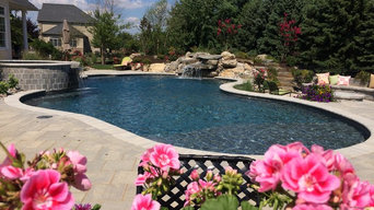 Bethlehem Township pool and spa with waterfall and sunshelf