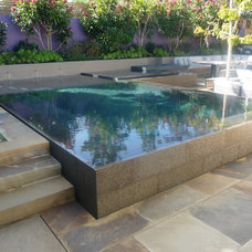 Modern Pool by John Crystal Pools, Inc.