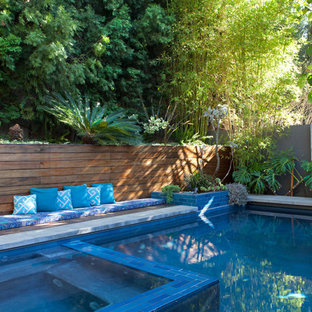 Example of a large mid-century modern backyard rectangular lap hot tub design in Los Angeles with decking