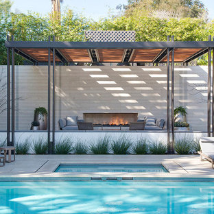 Inspiration for a huge contemporary backyard concrete paver and rectangular pool house remodel in Los Angeles