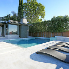 Modern Pool by THE CARRABBA GROUP