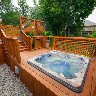 Mid-sized arts and crafts backyard custom-shaped hot tub photo in Toronto with decking