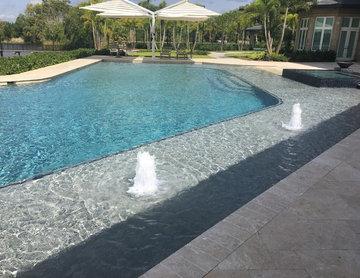 Big Custom Pool with a Rock Waterfall and Slide in Boca Raton