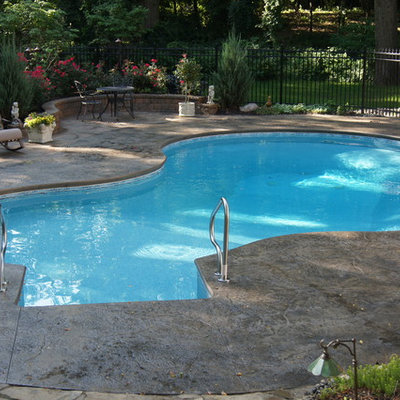 Inspiration for a mid-sized craftsman courtyard stamped concrete and custom-shaped aboveground pool remodel in Detroit