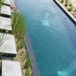 Inspiration for a large country backyard rectangular natural pool in New York with natural stone pavers.