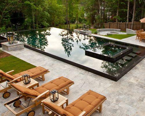 Lovely Example Of A Large Trendy Backyard Stone And Rectangular Infinity Hot Tub  Design In Atlanta