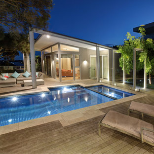 Inspiration for a contemporary rectangular pool in Melbourne with a hot tub and decking.