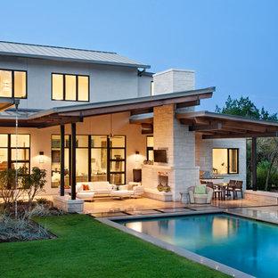 Ispirazione per una piscina minimal rettangolare dietro casa