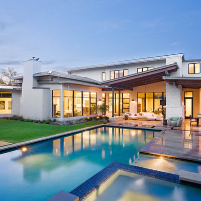 Inspiration for a huge contemporary backyard rectangular and tile lap hot tub remodel in Austin
