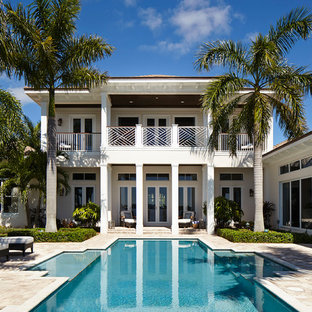 Inspiration for a large beach style backyard custom-shaped lap pool remodel in Miami