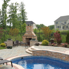 Traditional Pool by Carville Landscape Co.