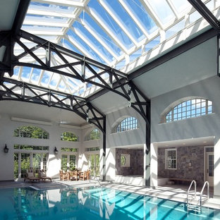 Inspiration for a timeless indoor pool remodel in Boston