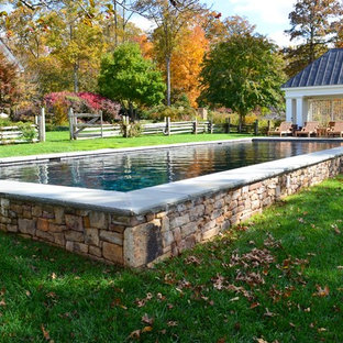 Photo of a large country backyard rectangular lap pool in DC Metro with a pool house.