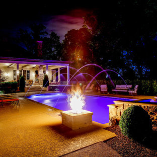 Mid-sized country backyard pool in Nashville with a water feature.
