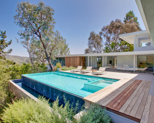 Example Of A Minimalist Infinity Pool Design In Los Angeles With Decking
