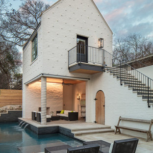 Transitional l-shaped pool house photo in Austin