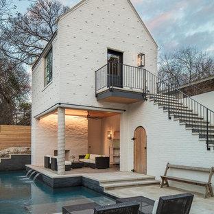 Ejemplo de casa de la piscina y piscina tradicional renovada en forma de L