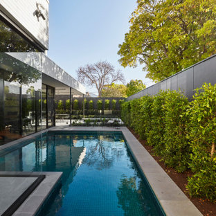 This is an example of a contemporary l-shaped pool in Melbourne.