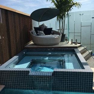 Foto de piscinas y jacuzzis actuales, rectangulares, en azotea