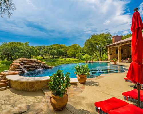 backyard pool designs. Example Of A Transitional Backyard Concrete And Custom-shaped Infinity Pool Fountain Design In Austin Designs