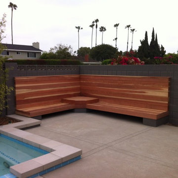 Built in wood bench near pool