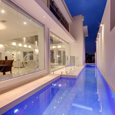 Mid-sized minimalist stone and rectangular lap pool photo in Brisbane