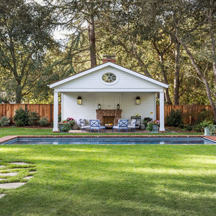 Photo of a large traditional back rectangular lengths swimming pool in San Francisco with a pool house and brick paving.