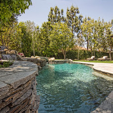 Traditional Pool by SOD BUILDERS, INC.