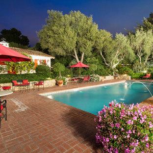 Inspiration for a mediterranean brick pool remodel in Austin