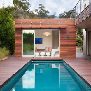 Design ideas for a medium sized contemporary back rectangular lengths swimming pool in Santa Barbara with decking and a pool house.
