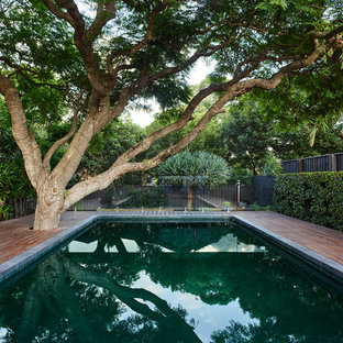 Design ideas for a large contemporary backyard rectangular lap pool in Sydney with decking.