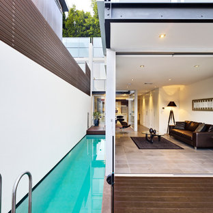 Photo of a contemporary side yard rectangular lap pool in Sydney with decking.