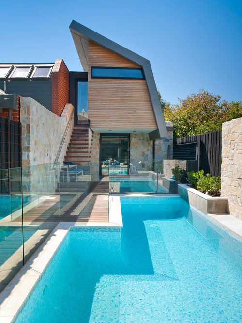 Outdoor Swimming Pool And Stone Patio Designs With A Seating Area ...