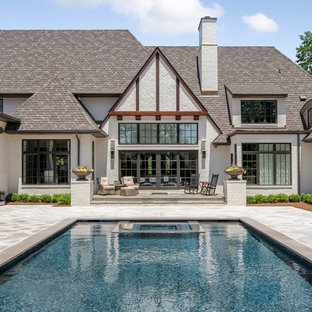Inspiration for a large farmhouse backyard tile and rectangular hot tub remodel in Charlotte