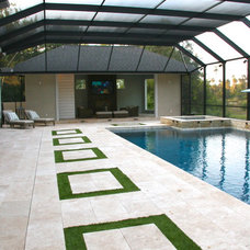Traditional Pool by Coastal Luxury Outdoors
