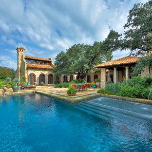 Tuscan courtyard pool photo in Austin