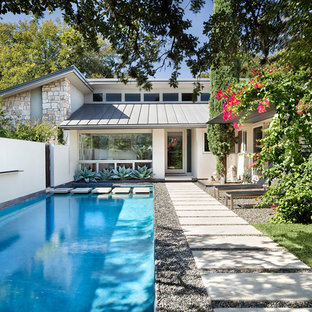 Mid Sized Trendy Front Yard Rectangular And Gravel Pool Photo In Austin