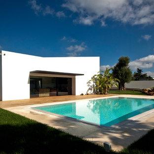 Idéer för att renovera en medelhavsstil rektangulär pool, med naturstensplattor
