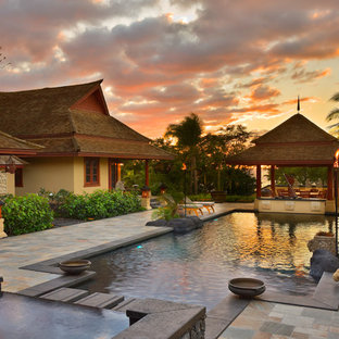 Inspiration for a mid-sized zen stone and rectangular infinity hot tub remodel in Hawaii