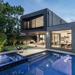 Design ideas for a contemporary backyard rectangular lap pool in Melbourne with a hot tub and concrete pavers.