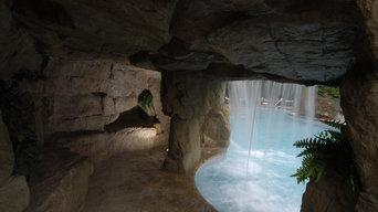 Cave-Grotto-Enclosed Slide with Waterfalls
