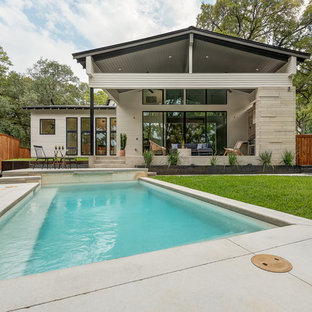 Design ideas for a small scandinavian backyard rectangular pool in Austin with concrete slab.