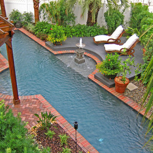 Inspiration for a tropical brick pool remodel in Orlando