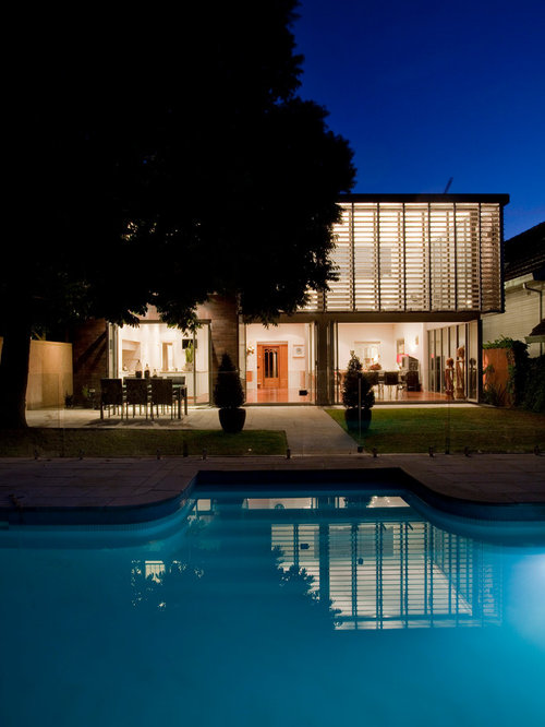 Example Of A Large Trendy Backyard Custom Shaped Natural Pool Design In  Sydney