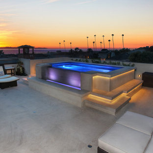 Example of a large trendy backyard concrete and rectangular pool design in Orange County