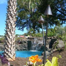 Tropical Pool by Falling Water Custom Pools, Inc.