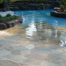 tropical pool by Falling Water Custom Pools, Inc.