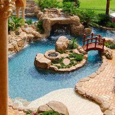 Mediterranean Pool by MJS Inc. Custom Home Designs