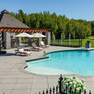 Elegant custom-shaped pool photo in Philadelphia